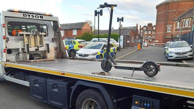 Photo of Police Grab A Scooter And Load It Onto A Huge Tow Truck: They Are Mocked On Social Media.
